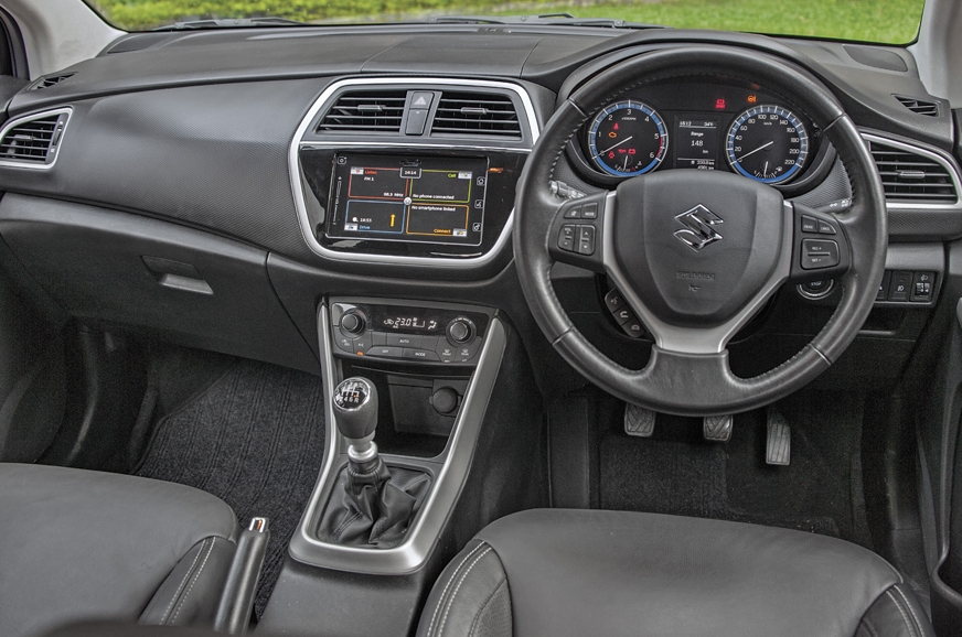 All-black interior with faux metal inserts look and feels...