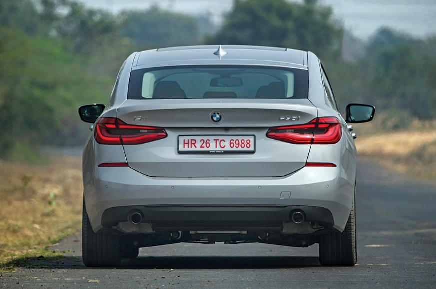 Wraparound tail-lamps do well to disguise the bulky rear.