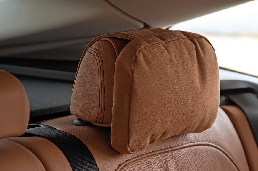 Soft pillow sits atop rear headrest.