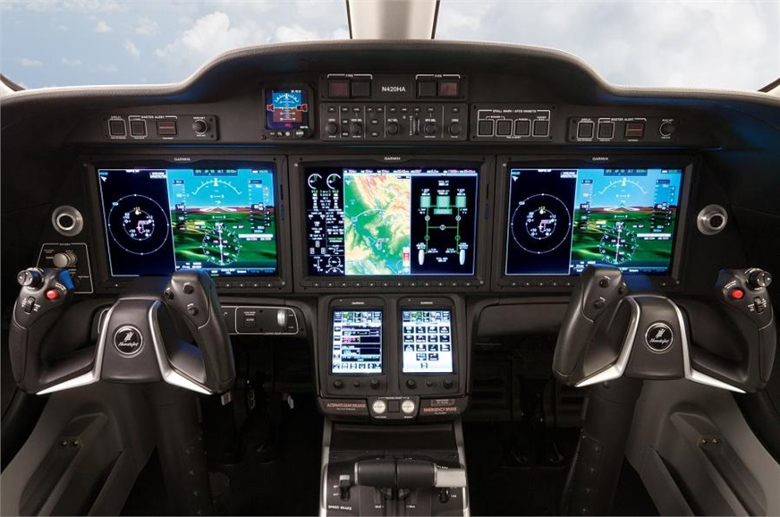 Digital cockpit is dominated by Garmin displays.