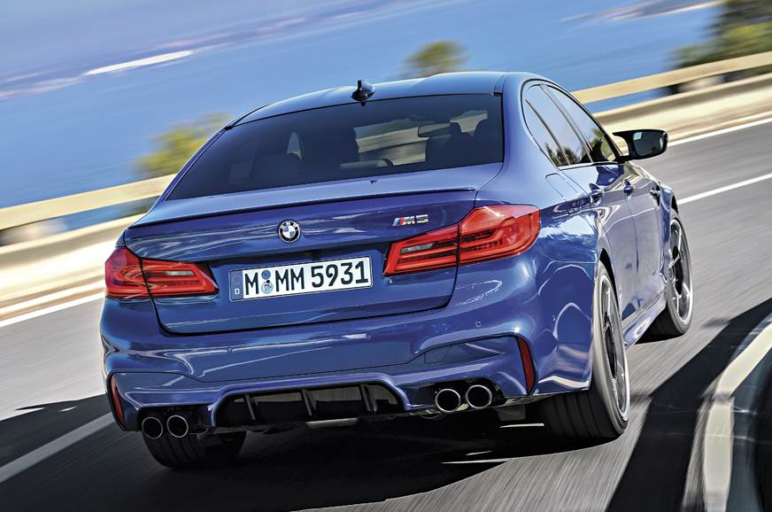 Rear diffuser and quad exhaust distinguish the M5 from a ...