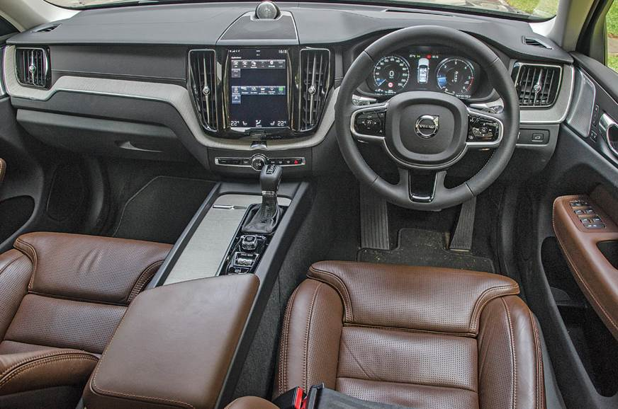Interiors shared with elder siblings, the XC90 and S90, a...