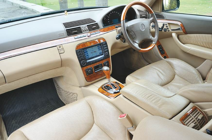 White and orange-on-black dials in the W140, classic MB.