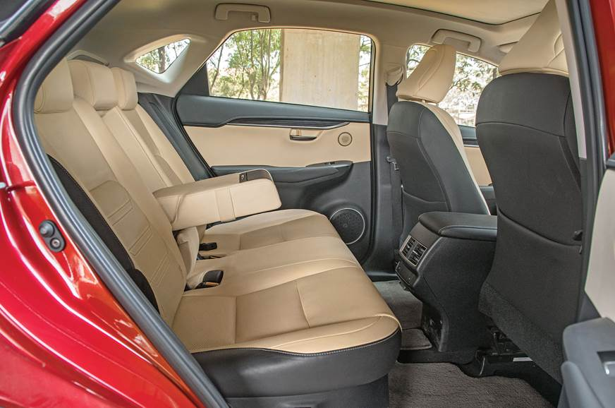 NX300h's rear seat is placed low and headroom is tight.