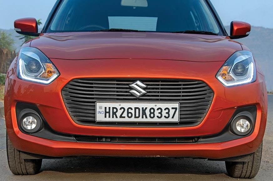 Sleeker bumper and all-black grille distinguish Swift fro...