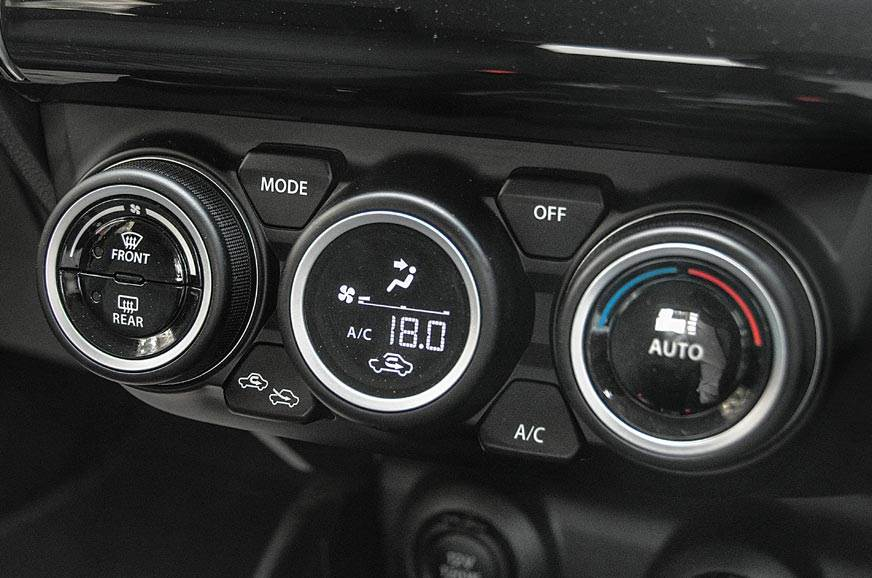 Air con controls look cool. Jaguar F-Type-like centre dia...
