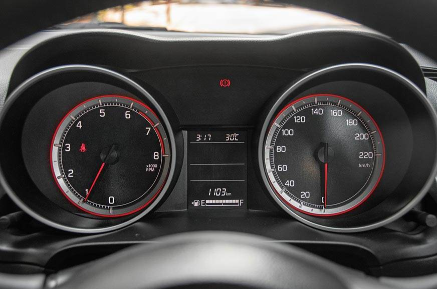 Hooded tacho and speedo dials with red detailing are very...
