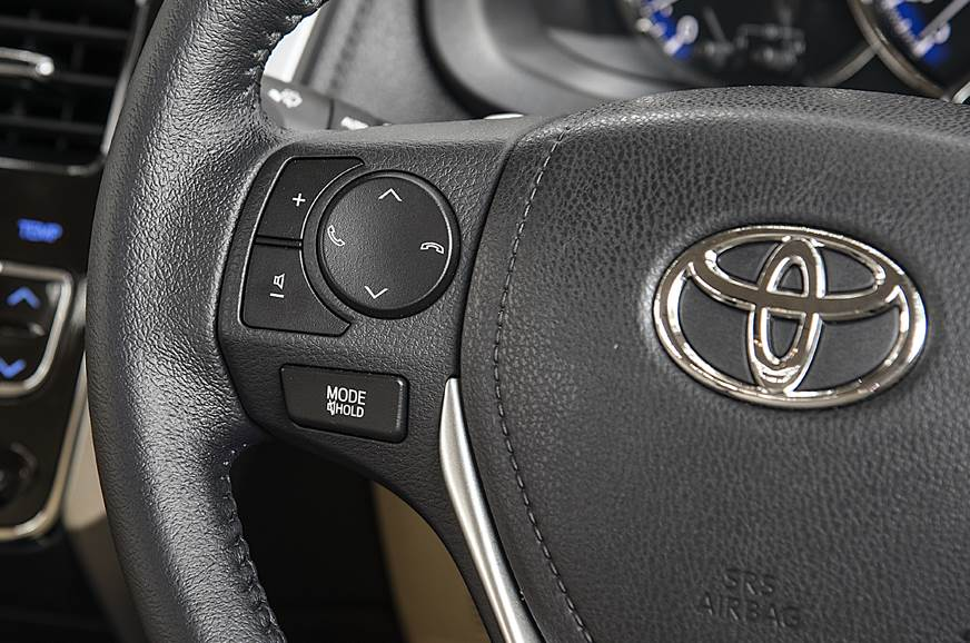 Chunky buttons on the steering wheel easy to use on the m...