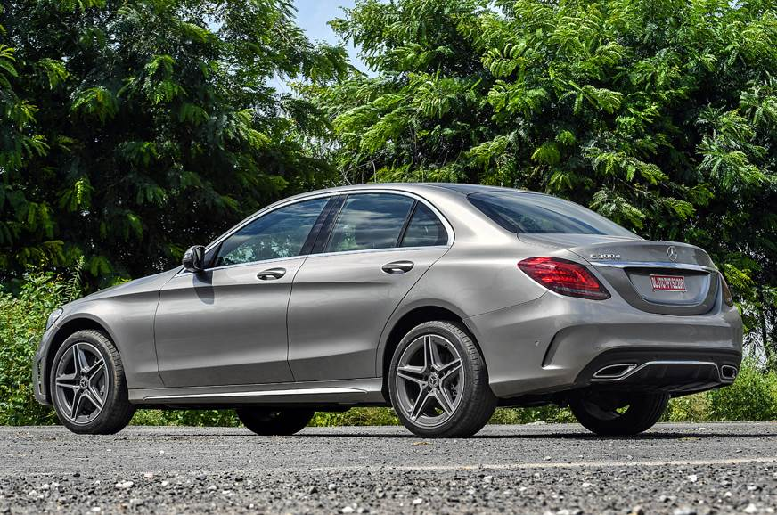 AMG Line trim on the C 300d gets more aggressive bumpers,...