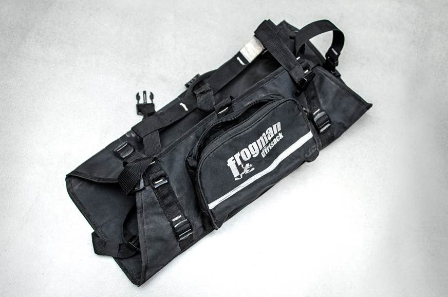 Black harness securely holds the bag.