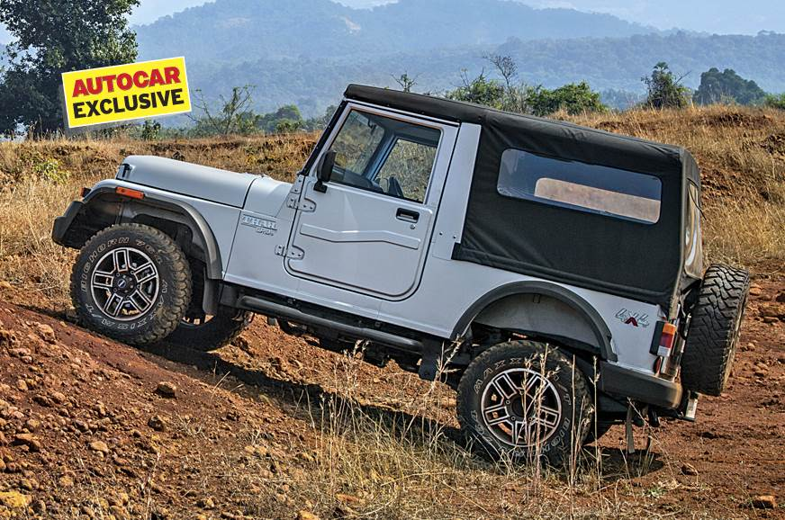 Standard Mahindra Thar used for representation only.