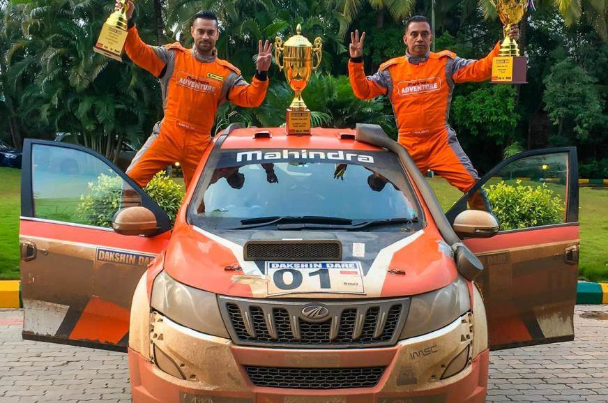 Gaurav Gill (R) with his co-driver Musa Sherif (L) with the winner's trophies