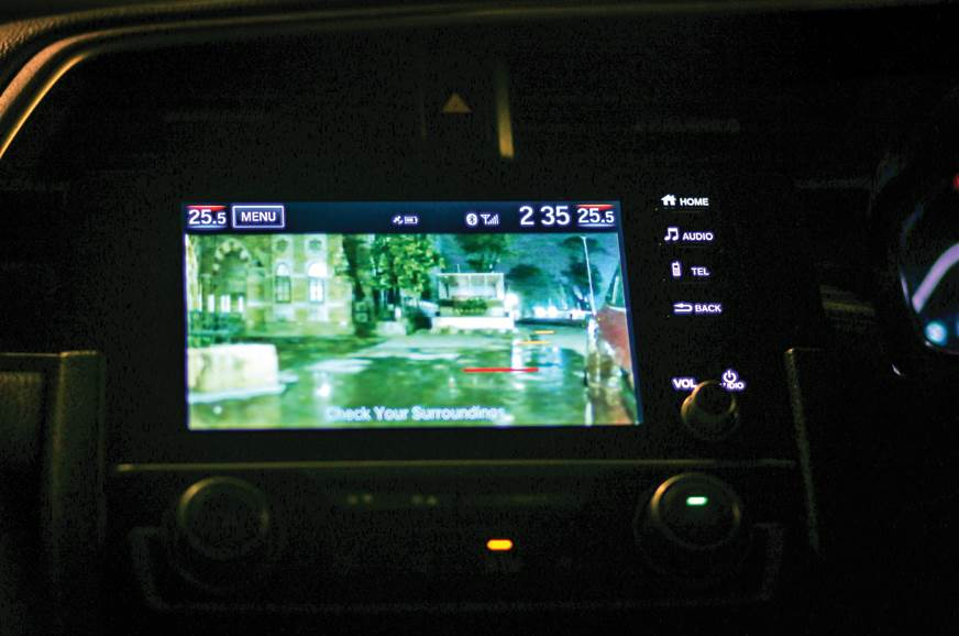 Lane Watch camera on the left wing mirror transmits image...