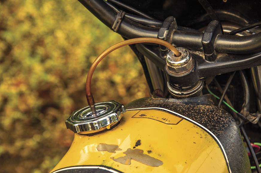 Breather pipe from the fuel cap lubricates the steering h...