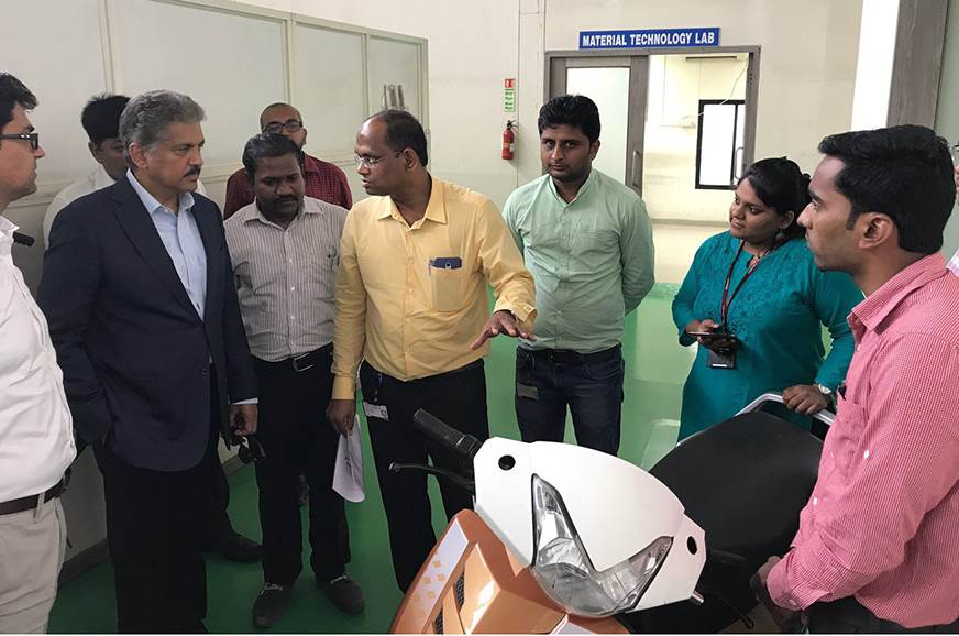 April 2017: Anand Mahindra, chairman, Mahindra Group with the then under-development e-scooter.