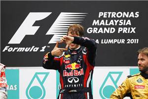 Vettel eases to victory in Malaysia