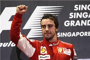 Alonso holds off Vettel for win