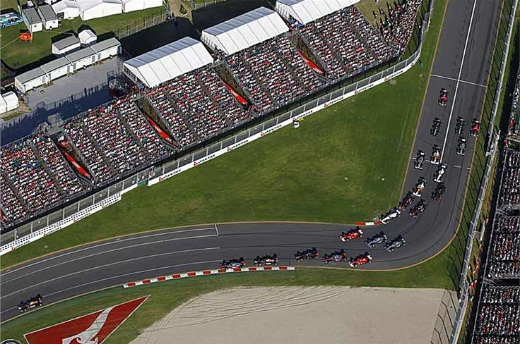 This would become a thoroughly predictable sight during 2011; the pack bunch up for the first corner at Melbourne, but Vettel is already well clear.