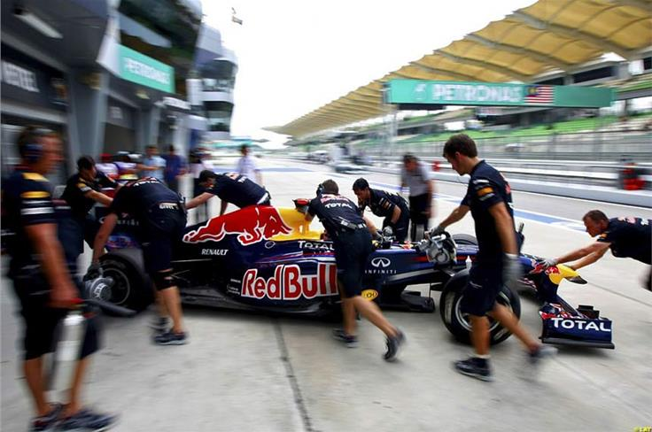 Without the Red Bull team - seen here in the Sepang pitlane - on hand to support his efforts, Vettel is just a guy in a car.