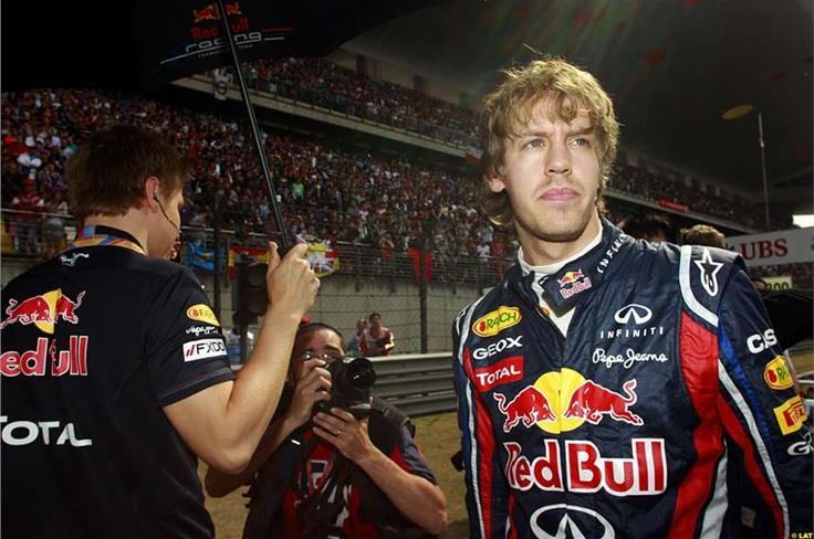 A few more fans turn up on raceday to watch Vettel - on pole again - attempt to keep up his perfect start to the season.