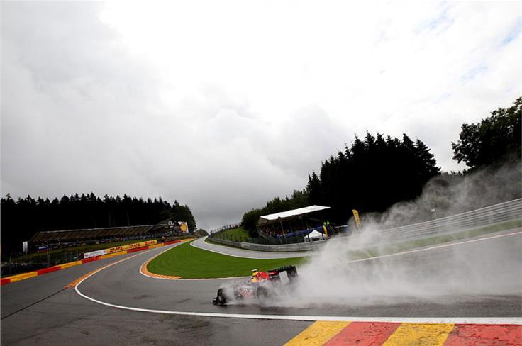 Rain at Spa leads to a Vettel pole but a protracted argument after Red Bull cambers its wheels beyond Pirelli's safe limit for dry conditions...
