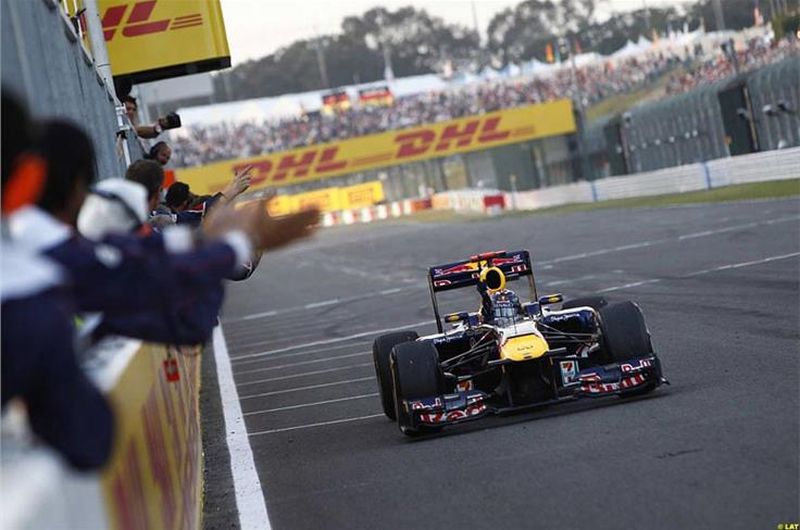 Vettel crosses the line at Suzuka to become world champion for a second time.