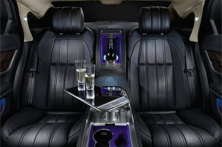 A full-length, leather-trimmed centre console separates the two individually tailored rear seats which feature power adjustment, ventilation, massage and lumbar functions. A table, machined from solid aluminium with piano-black and chrome detailing, rises up from the centre console at the touch of a button to provide a working area, its role supplemented by the provision of two third-generation iPads® with wireless keyboards that are housed in bespoke leather-trimmed docks in the rear of the front seats.