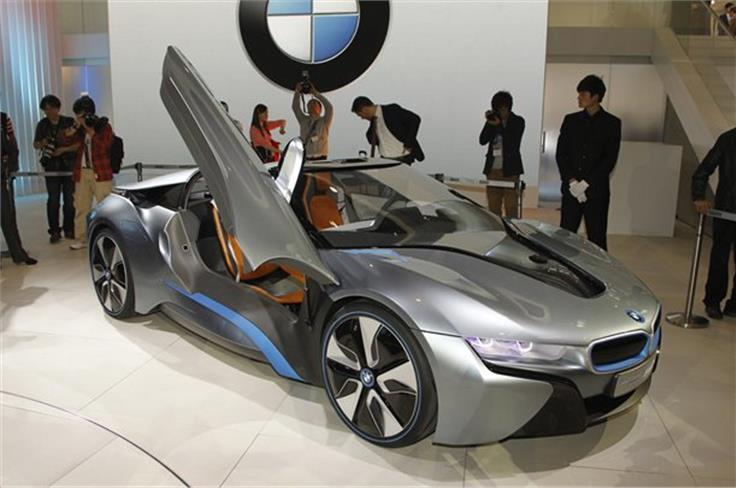 The BMW i8 Spyder previews an open-top version of BMW's new hybrid sports car for 2015