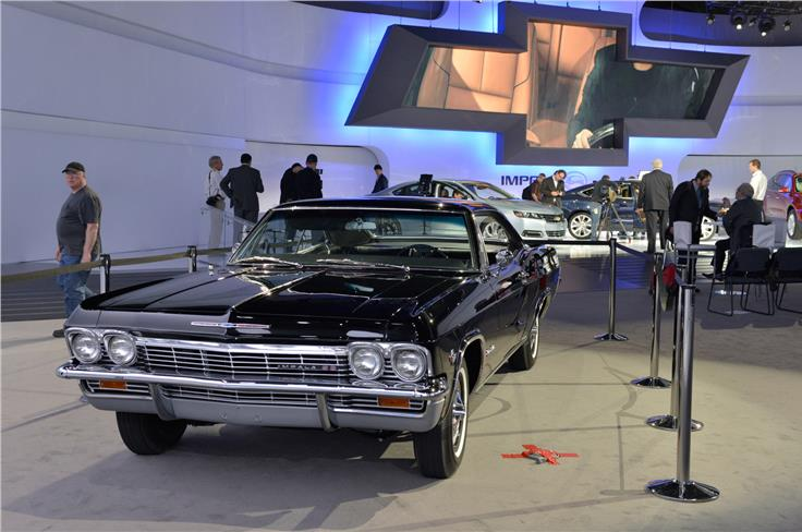 Early Chevrolet Impala is on show with the latest model