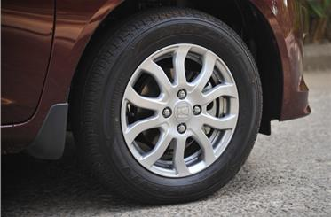 Amaze petrol gets a different alloy-wheel design.