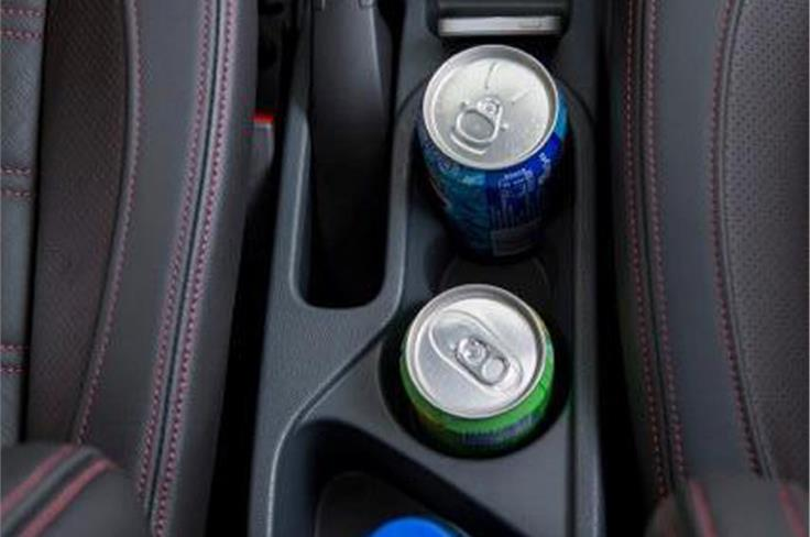 There are a fair number of storage spaces and cupholders in the spacious cabin
