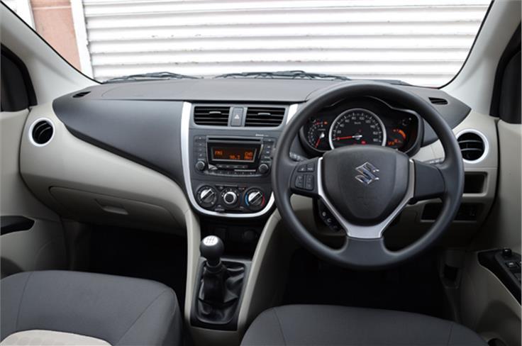 Dashboard looks upmarket, steering wheel shared with higher Maruti models like the swift.