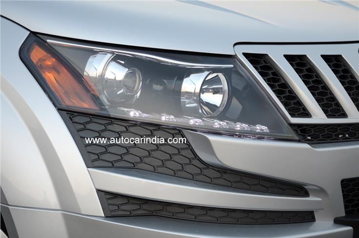The intricate headlight clusters remain, with LED daytime running lights and projector lamps. The fog lamps are missing though.