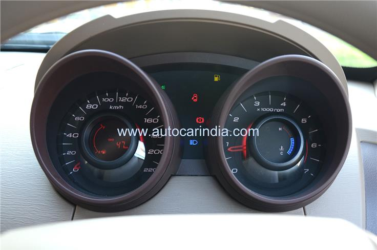 The chrome accents on the instrument cluster and elsewhere in the cabin are missing on the W4 as well.
