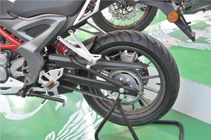 Monoshock does suspension duty at rear, mounted on a box-section swingarm and  chain final drive.