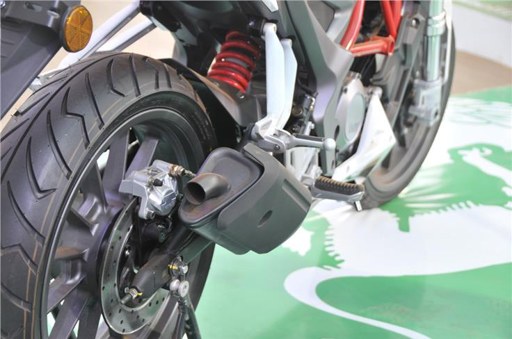 Short silencer is finished in black, monoshock is seen at rear with a box-section swingarm.