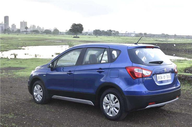 The S-Cross gets black body cladding and faux skid plates all around to give it the crossover look.