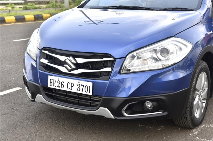 The S-Cross gets a dual-slat chrome grille along with chrome inserts around the fog lamps.