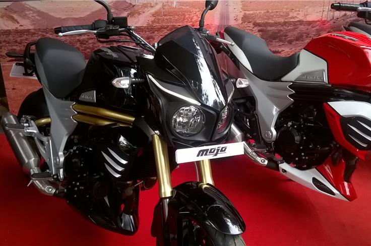 The motorcycle gets twin pod headlamps with DRL's and top-spec upside down front forks