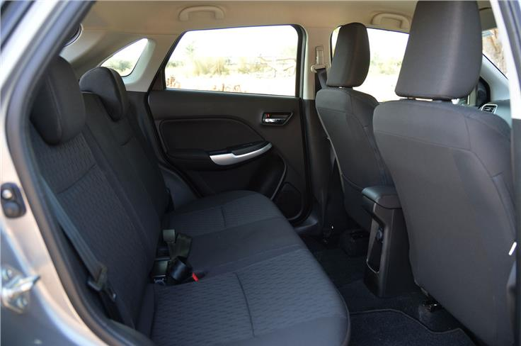 The rear seat is spacious and offers good legroom and can seat three abreast though headroom can get a bit tight.