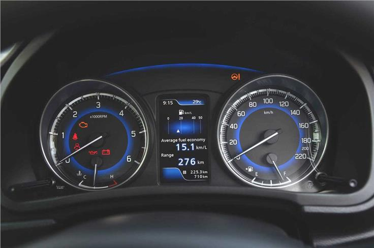 The blue backlight instrument panel stands out in the all-black interior.
