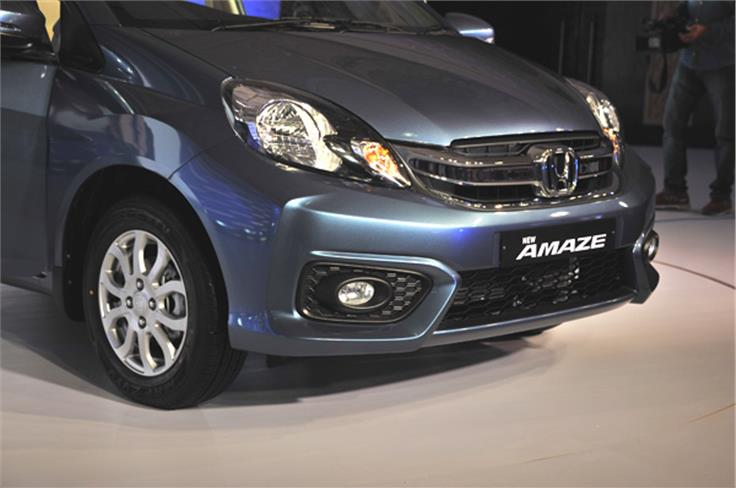The redesigned front bumper with integrated fog lamps give the Amaze a Mobilio-like stance from the front.