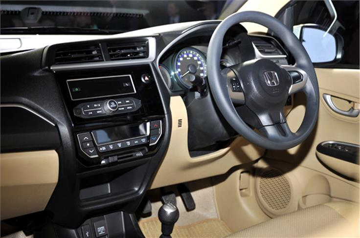 An automatic air-conditioning system with digital controls is now standard across all variants of the Amaze.