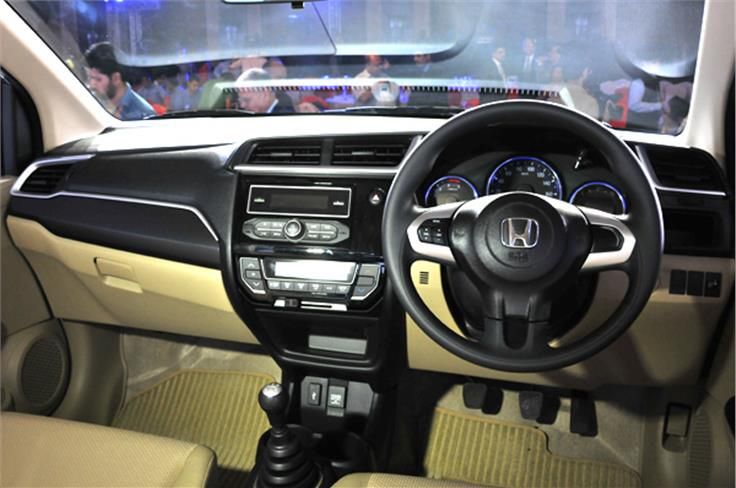 The two-tone beige & black interior scheme is maintained, but the new design and materials feel really top-notch.