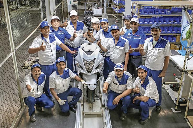 The men in white make the Hayabusa in India. The men in blue, Yoshiaki Harada (left) and Suresh Babu (right), helped get this project off the ground.