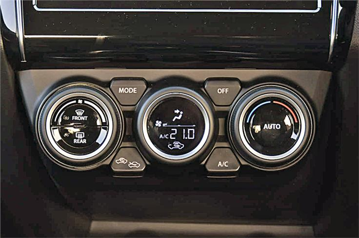 Climate control knobs differ from those on the Dzire. Centre dial comes with inset LED display.