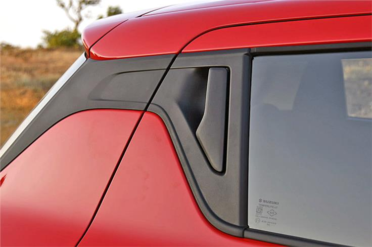 Love it or hate it, but the new Swift's rear door release sits just aft the window.