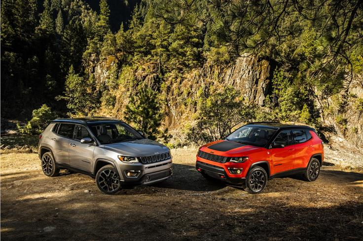 The standard Compass side-by-side with the hadrcore Trailhawk version (both models are international-spec).