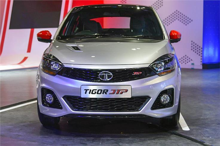Sporty bumpers, side skirts, new wheels and a bonnet scoop set it apart from the standard Tigor.