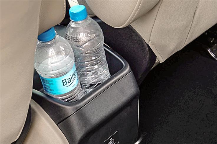 Bottle holders everywhere. Single USB charging port for back seat.
